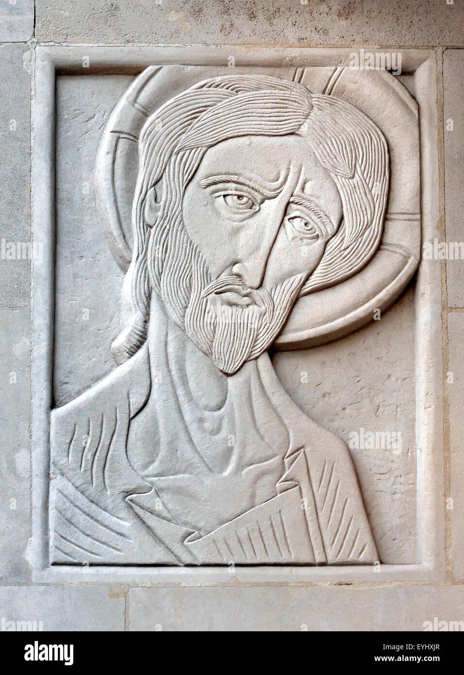 London, England, UK. St Martin's School of Art, Charing Cross Rd.  Carved stone panel by Adolfine Ryland: St - Stock Image