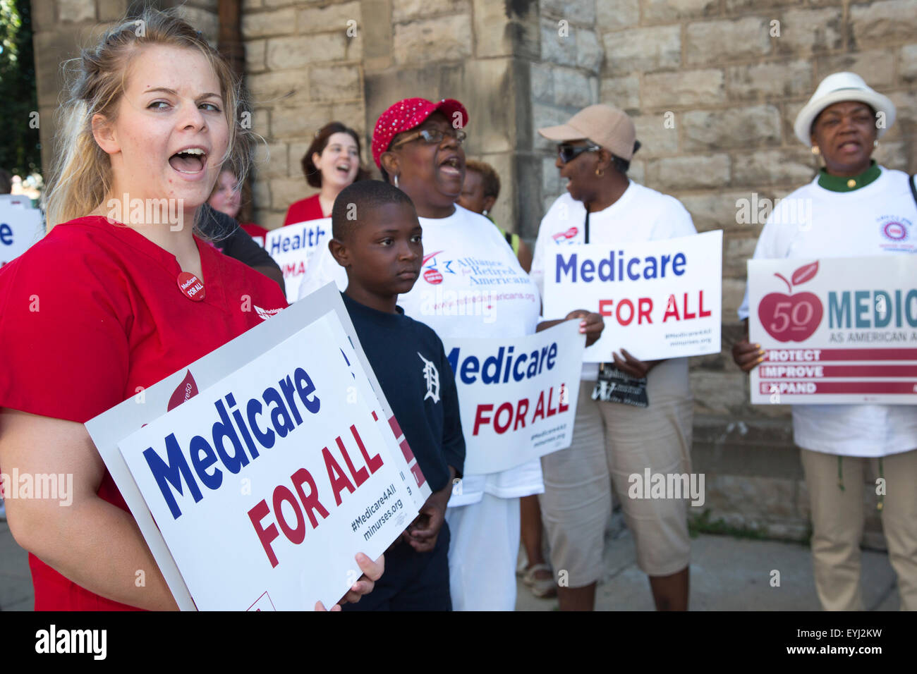 Detroit, Michigan, USA. 30th July, 2015.  Nurses, union members, and retirees rally to improve Medicare, as they - Stock Image