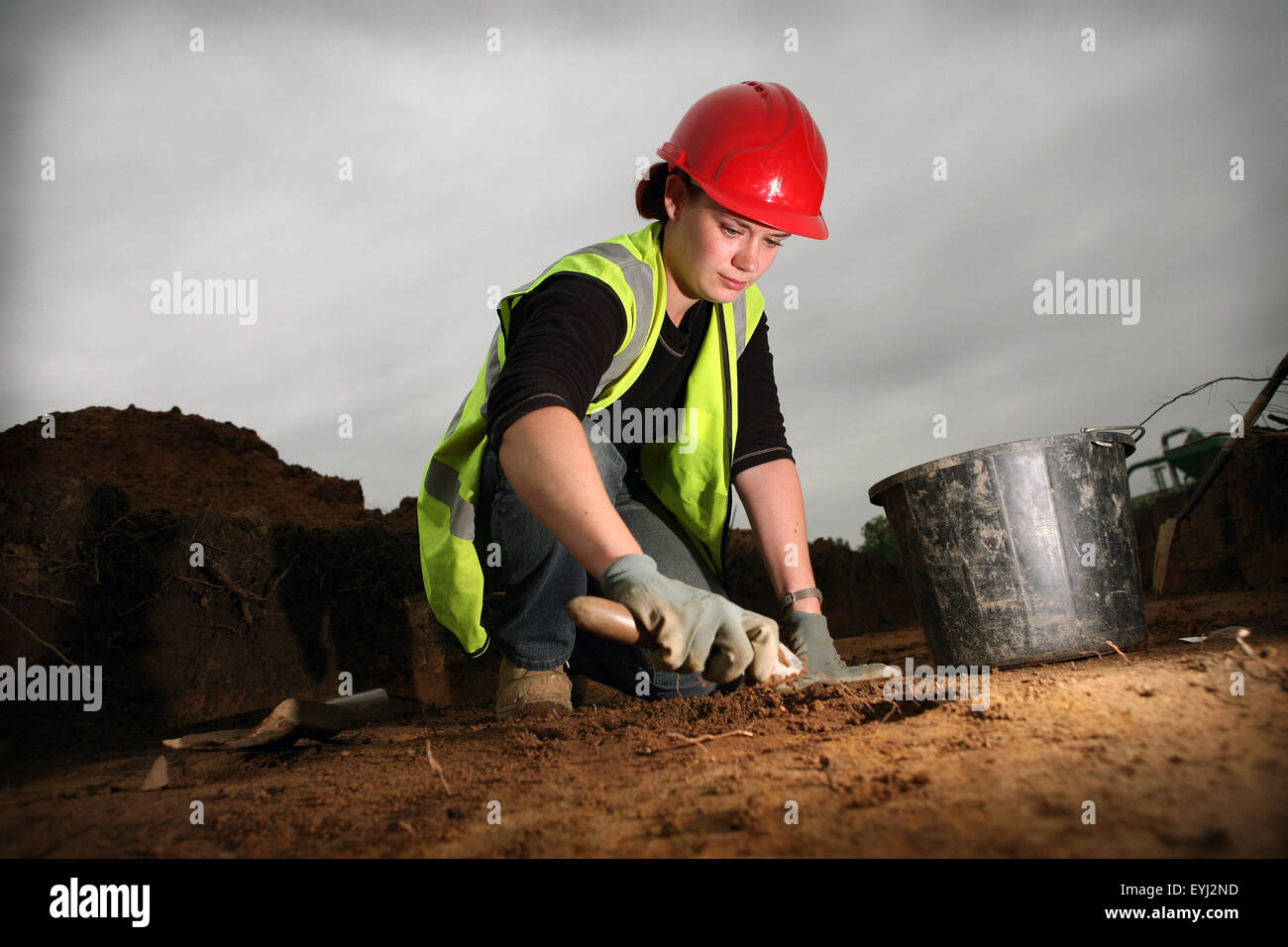 Archaelogical dig at City of Salford Stadium site. Archaelologist Jo Wright,31, excavates a linear feature. - Stock Image
