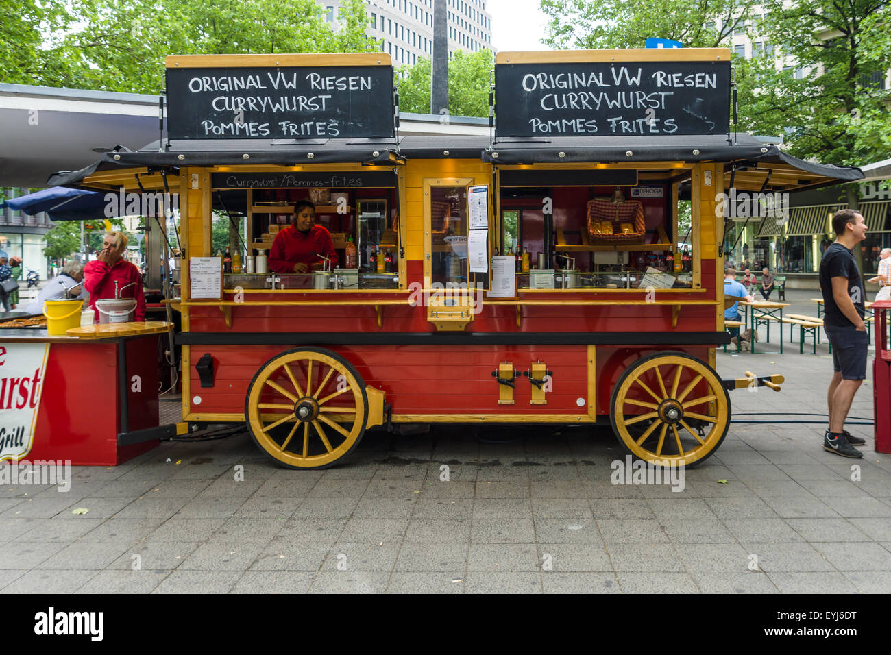 BERLIN - JUNE 14, 2015: Mobile cafes in the form of old wagon on the famous shopping street of West Berlin - Kurfuerstendamm. Stock Photo