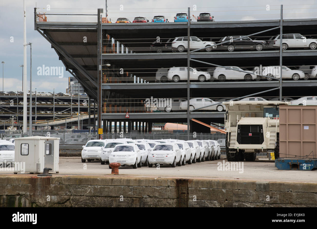 Luxury cars wrapped for protection for export from the UK on the docks at Southampton - Stock Image