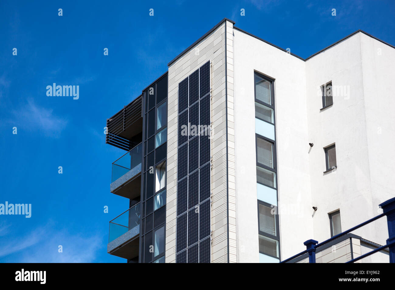 Modern apartment building with solar panels on the side - Stock Image