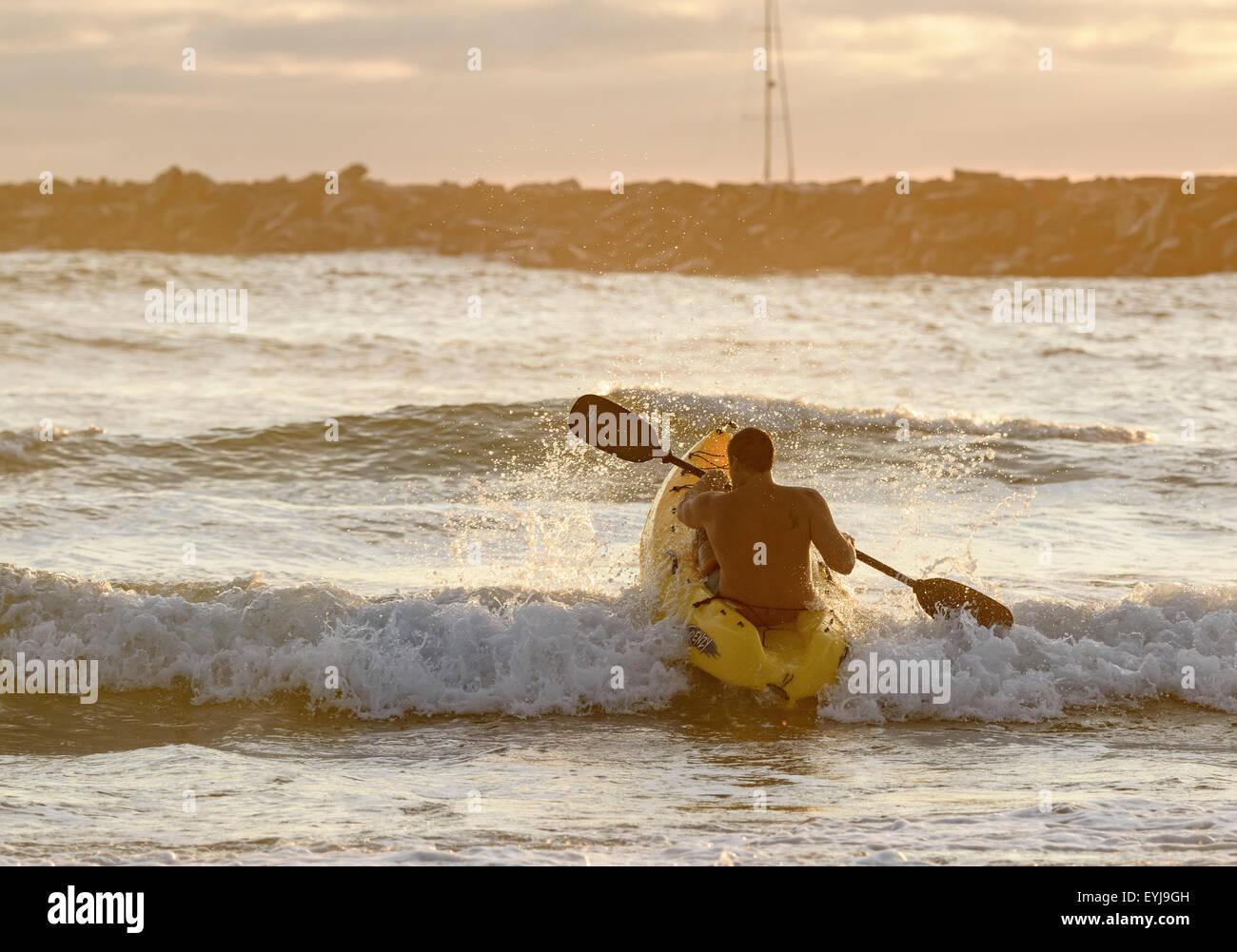 Man kayaking surf at Ocean Beach, CA - Stock Image