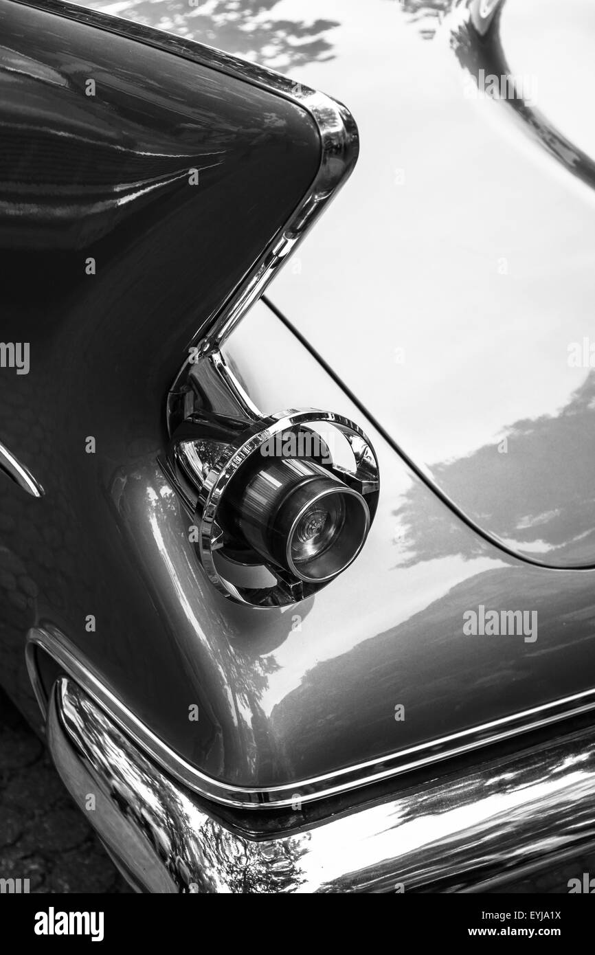 Stoplight of a luxury car Imperial Custom 4-door Southampton, 1961. Black and white. The Classic Days on Kurfuerstendamm. - Stock Image