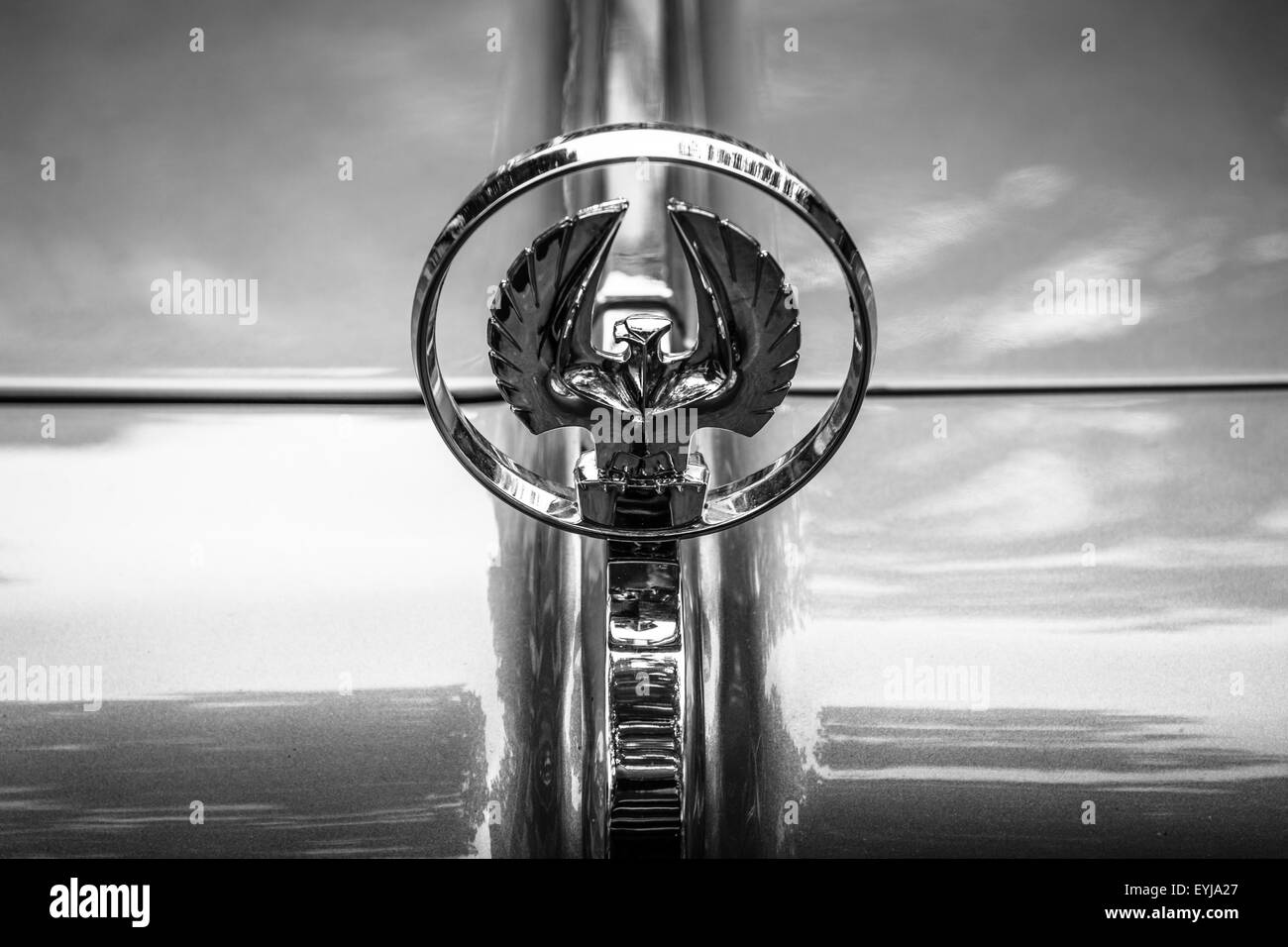 Hood ornament of a luxury car Imperial Custom 4-door Southampton, 1961. Black and white. The Classic Days on Kurfuerstendamm. - Stock Image