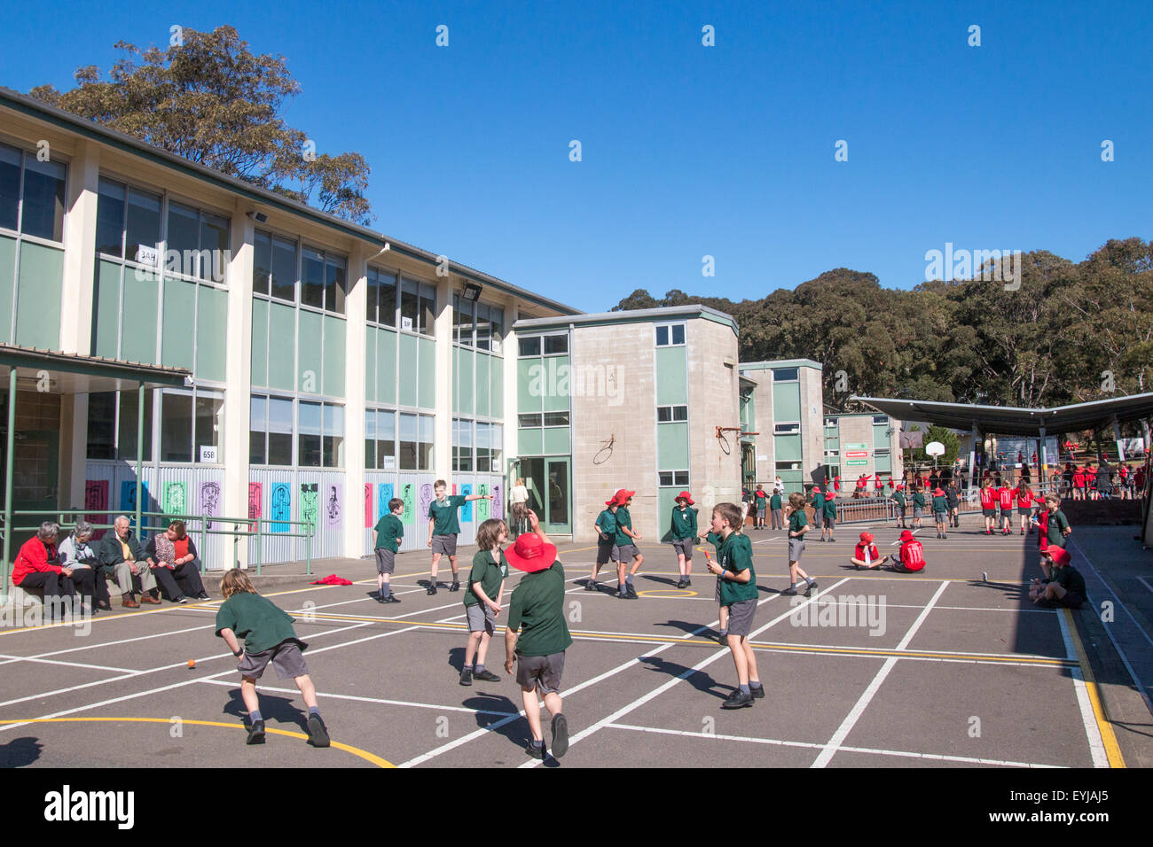 school children playing games in their primary school playground,Sydney,Australia - Stock Image