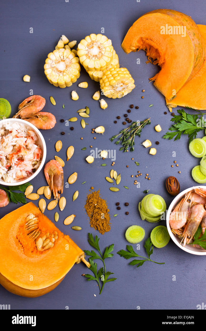 Raw ingredients for vegetable and seafood soup shot from above - Stock Image