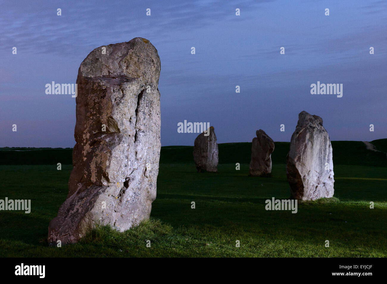Part of the stone circle at Avebury, Wiltshire, sidelit in the evening. Stock Photo