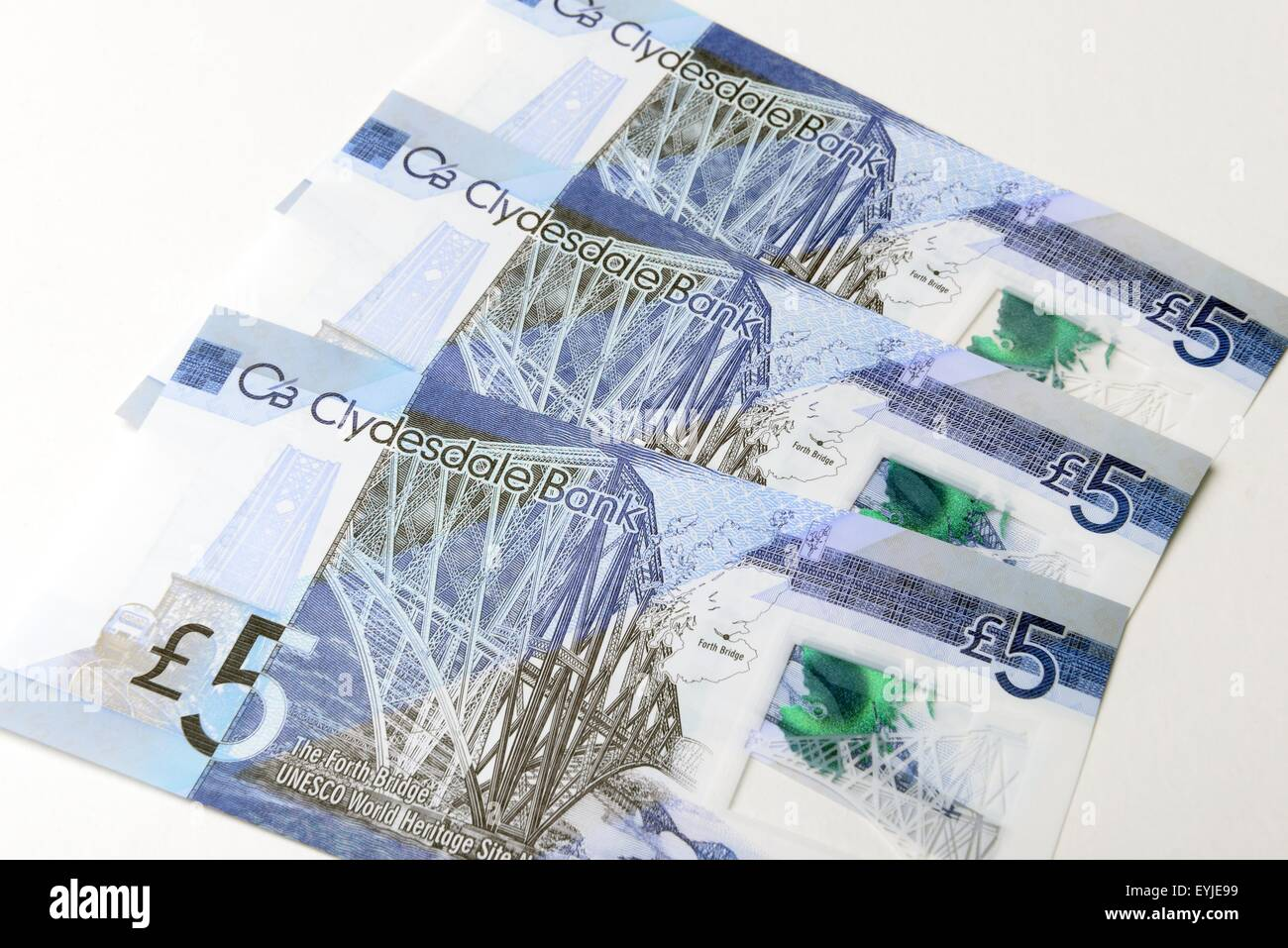 Clydesdale bank plastic £5 notes showing the newly designated world heritage Forth rail bridge in Scotland, - Stock Image