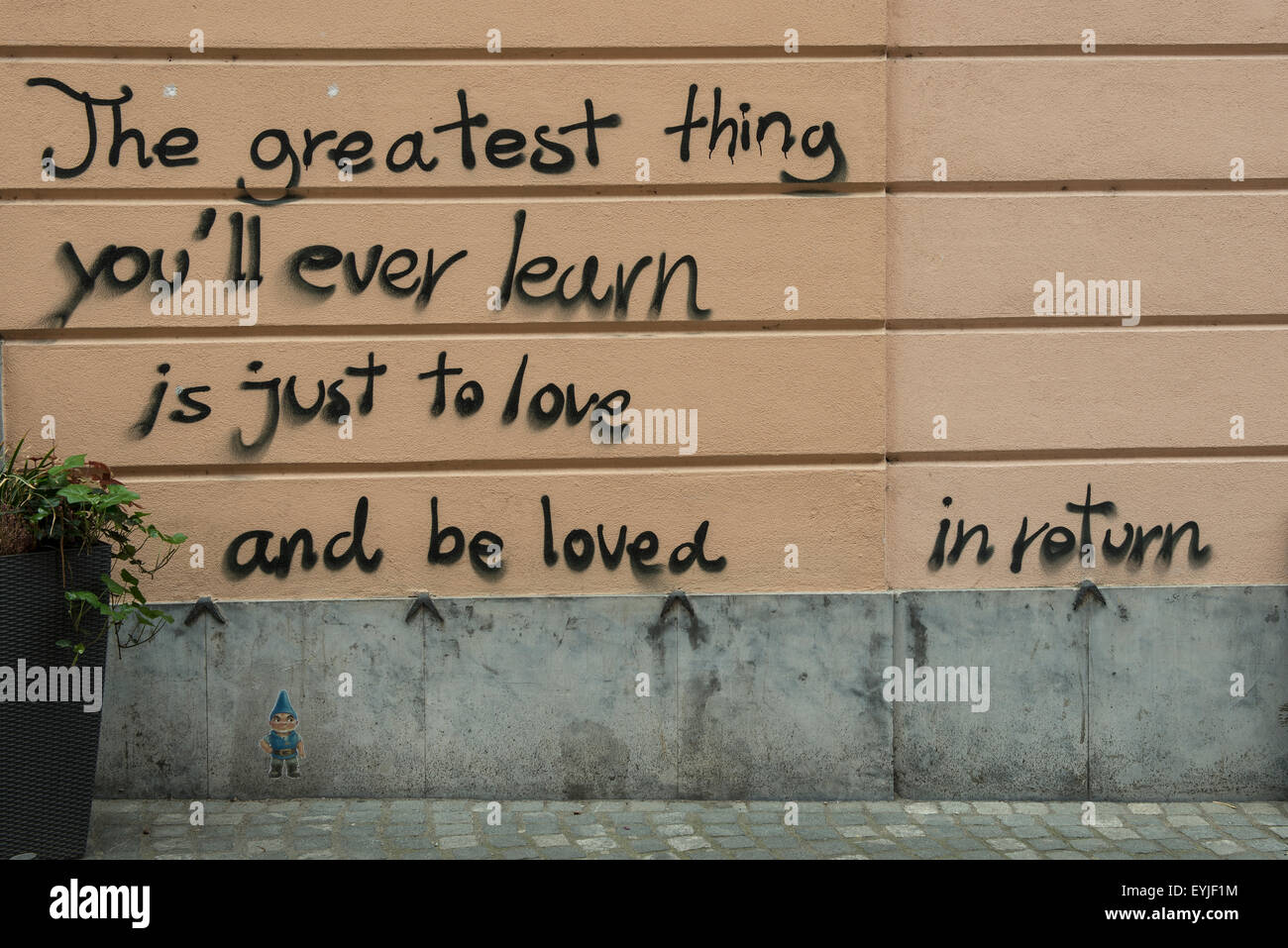 love written on the wall of the city - Stock Image