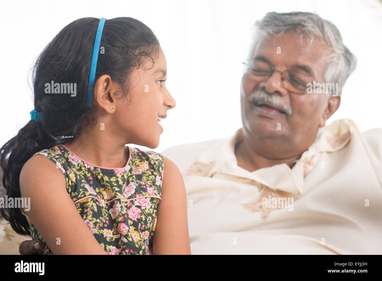 portrait of indian family at home grandparent and grandchild having