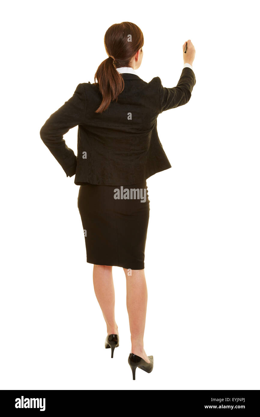 Business woman writing with a pen from behind - Stock Image
