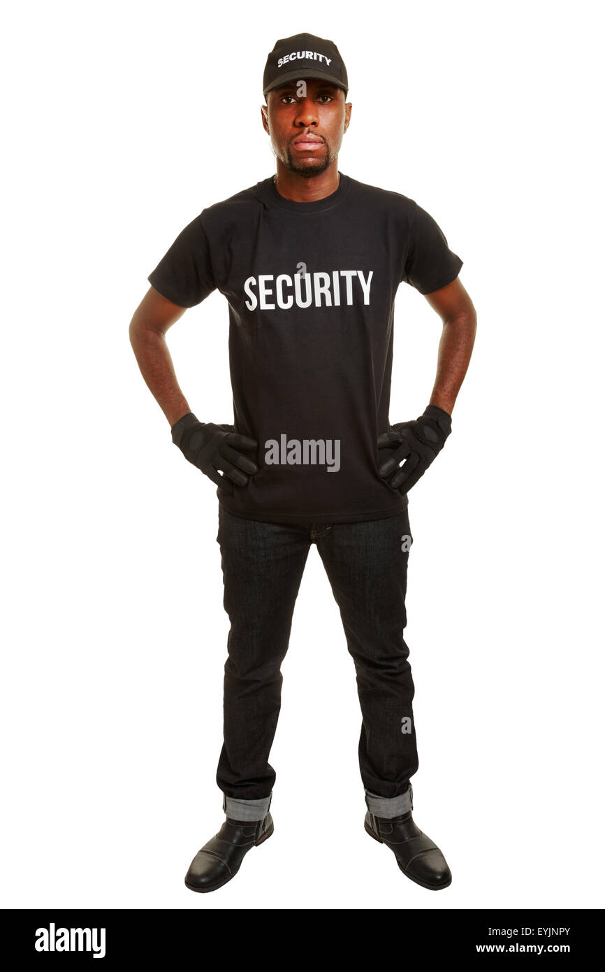 Security guard from security firm standing with arms akimbo - Stock Image