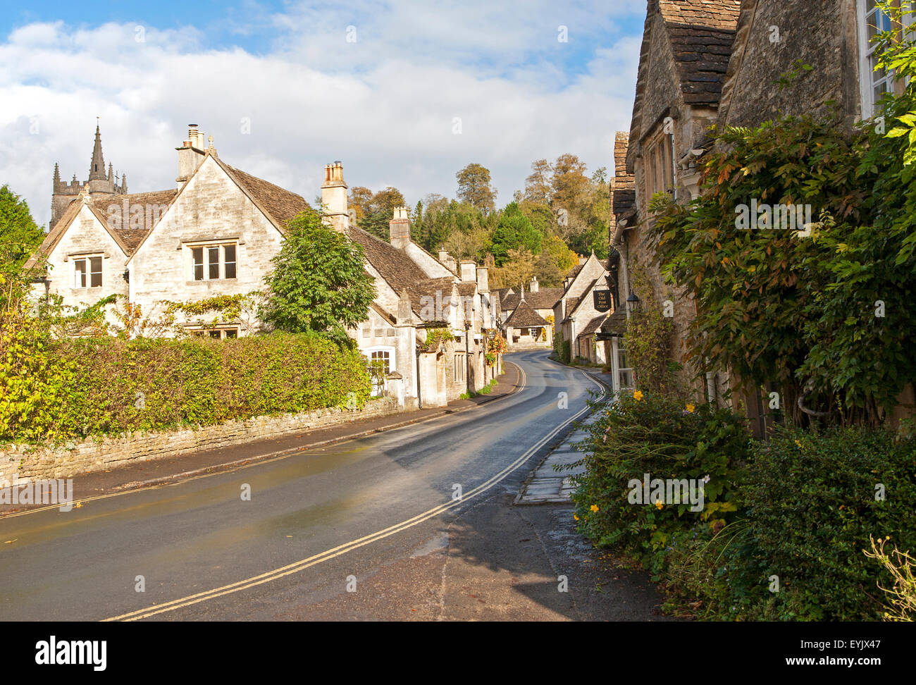 Attractive stone cottages in Castle Combe, Wiltshire, England, UK claimed to be England's prettiest village - Stock Image