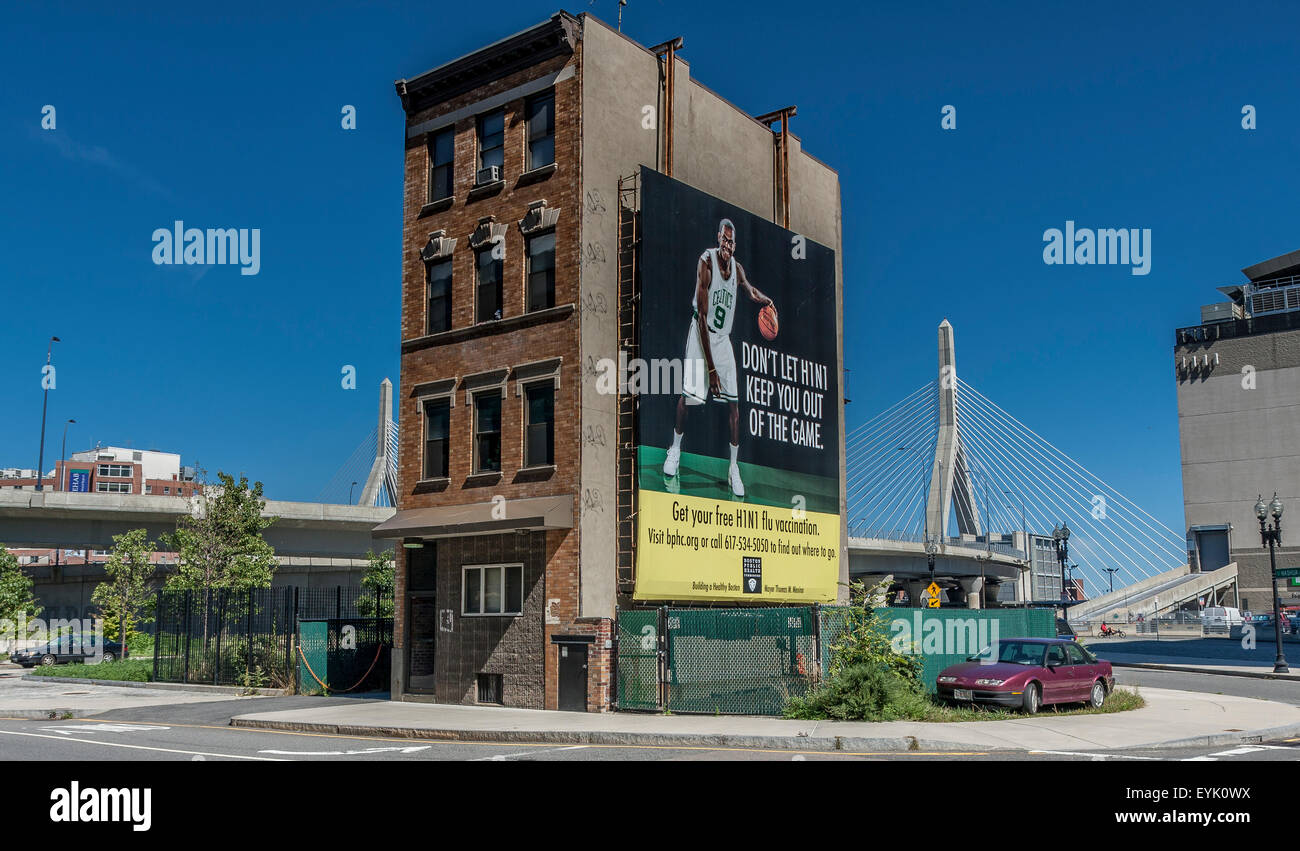 Old Building near The TD Garden with  Boston Celtics Basketball Player on a billboard with the Zakim Bridge in the - Stock Image