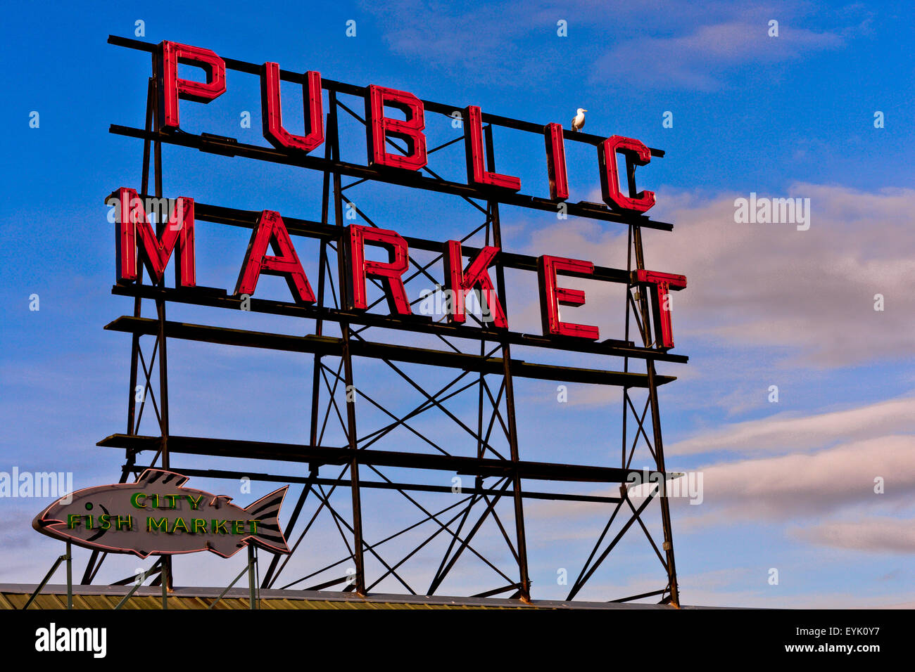 Large Iron And neon sigh above Pike Place Market in Seattle, famous for it's locally caught fish and Farmer's - Stock Image