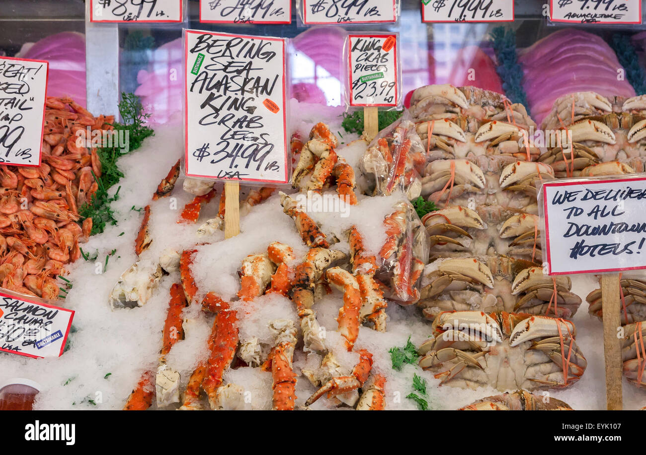 Freshly caught sea food on display at the Fish Counter at Pike Place Market , Seattle , Washington State , USA - Stock Image