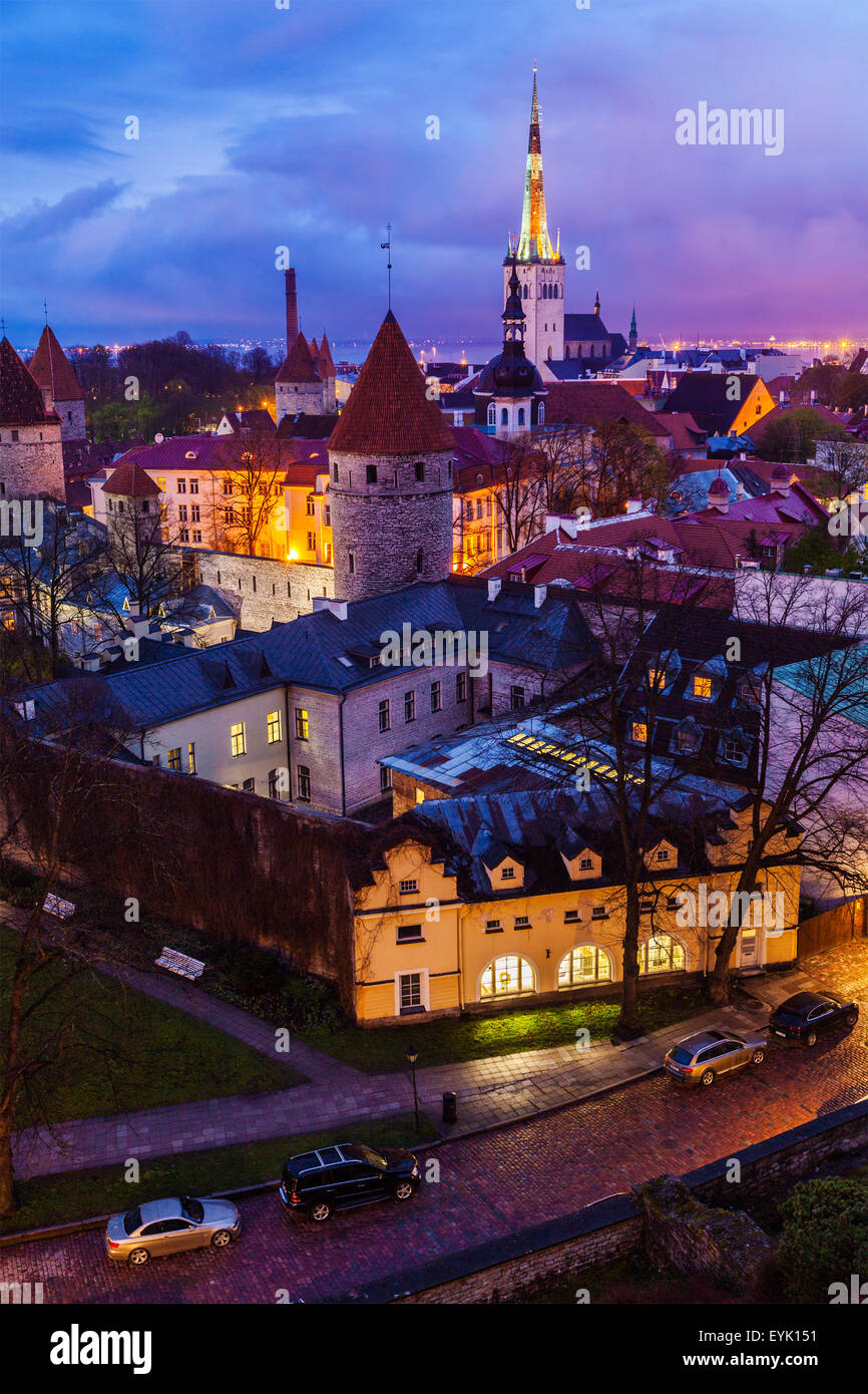 Aerial view of Tallinn Medieval Old Town illuminated in evening, Estonia - Stock Image
