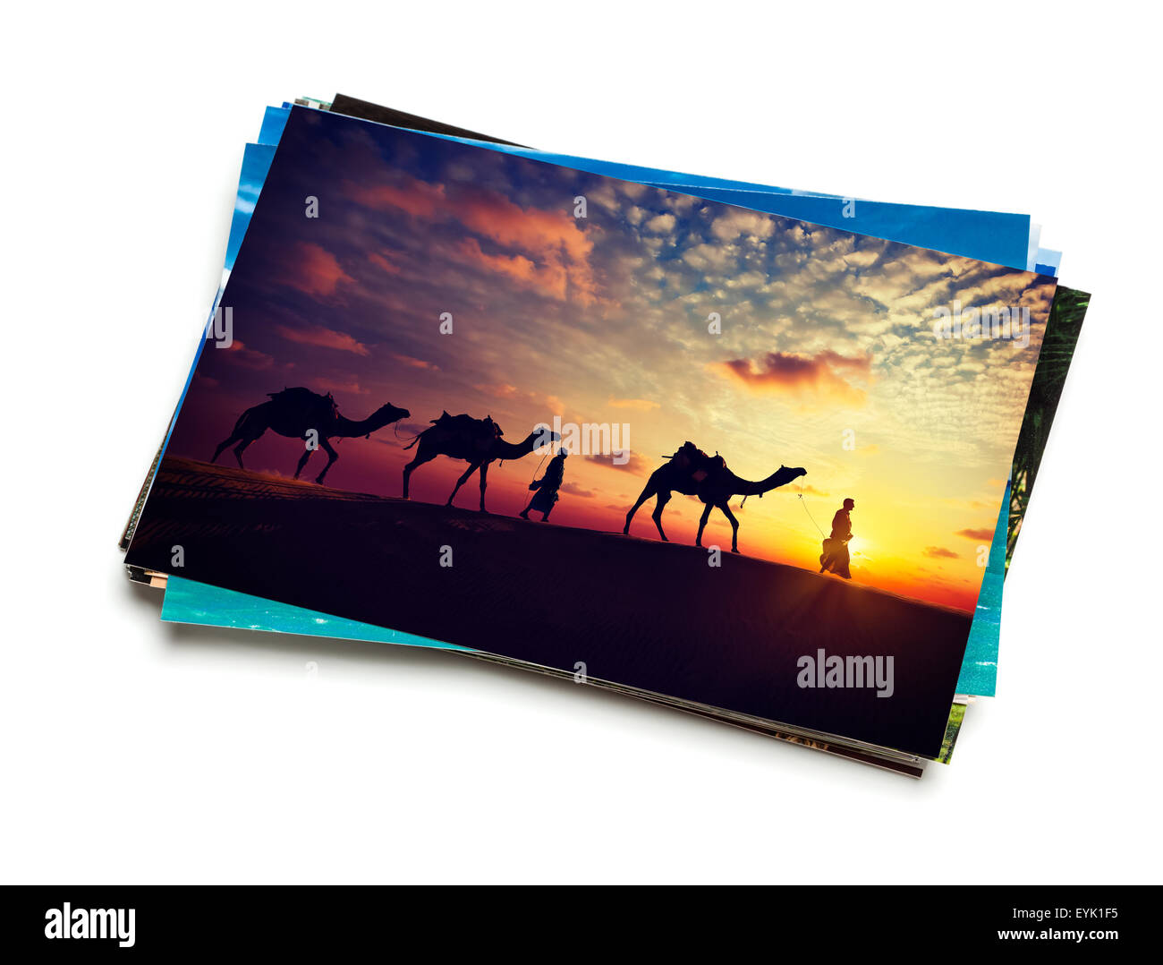 Holidays travel concept creative background - stack of vacation photos with camel caravan sunset image on top isolated - Stock Image