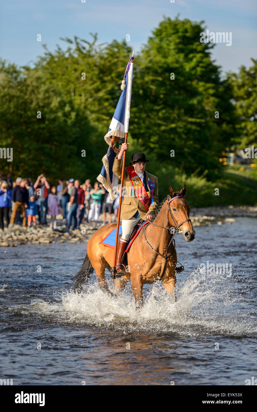 Selkirk Common Riding 2015. The Standard-bearer crosses the River Ettrick. - Stock Image
