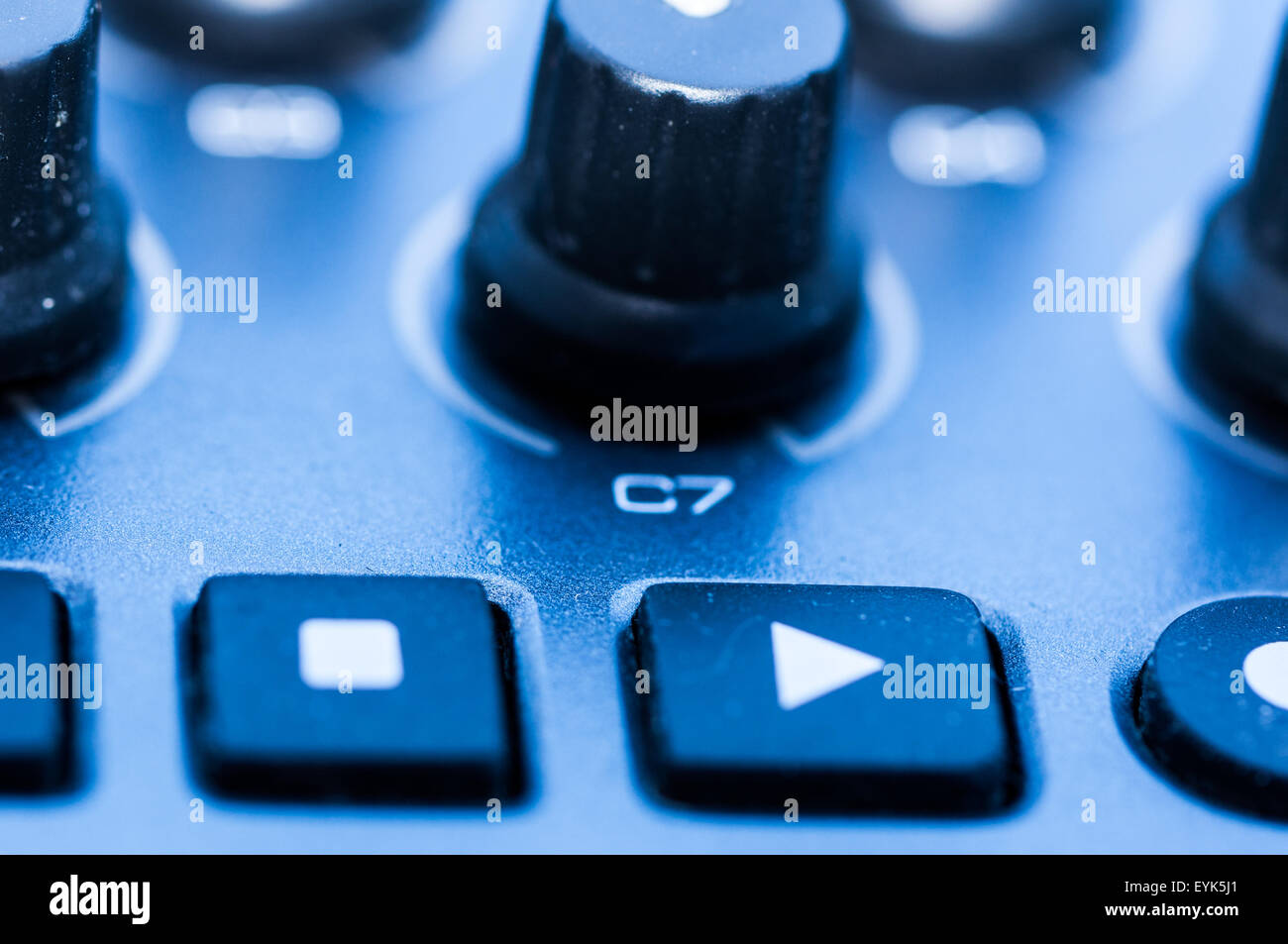 Synthesizer patch panel Close-up button knob on touch panel - Stock Image