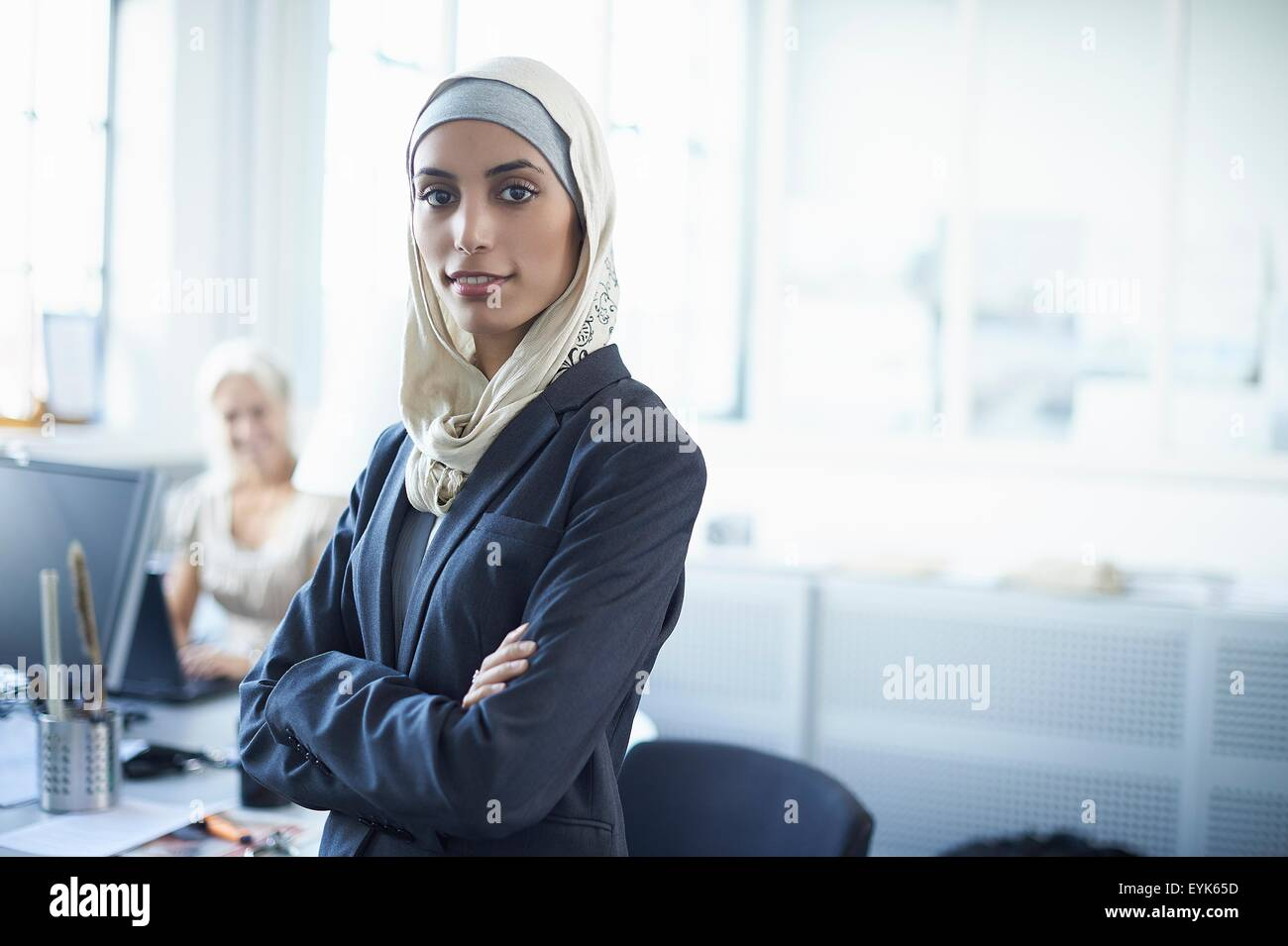 Portrait of young businesswoman wearing hijab in office - Stock Image