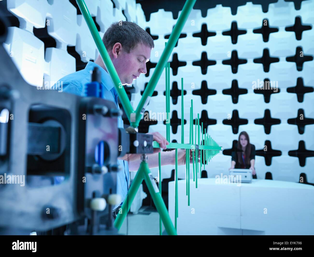 Engineers checking a bilog antenna for electromagnetic compatibility (EMC) radiated immunity testing in a semi anechoic - Stock Image