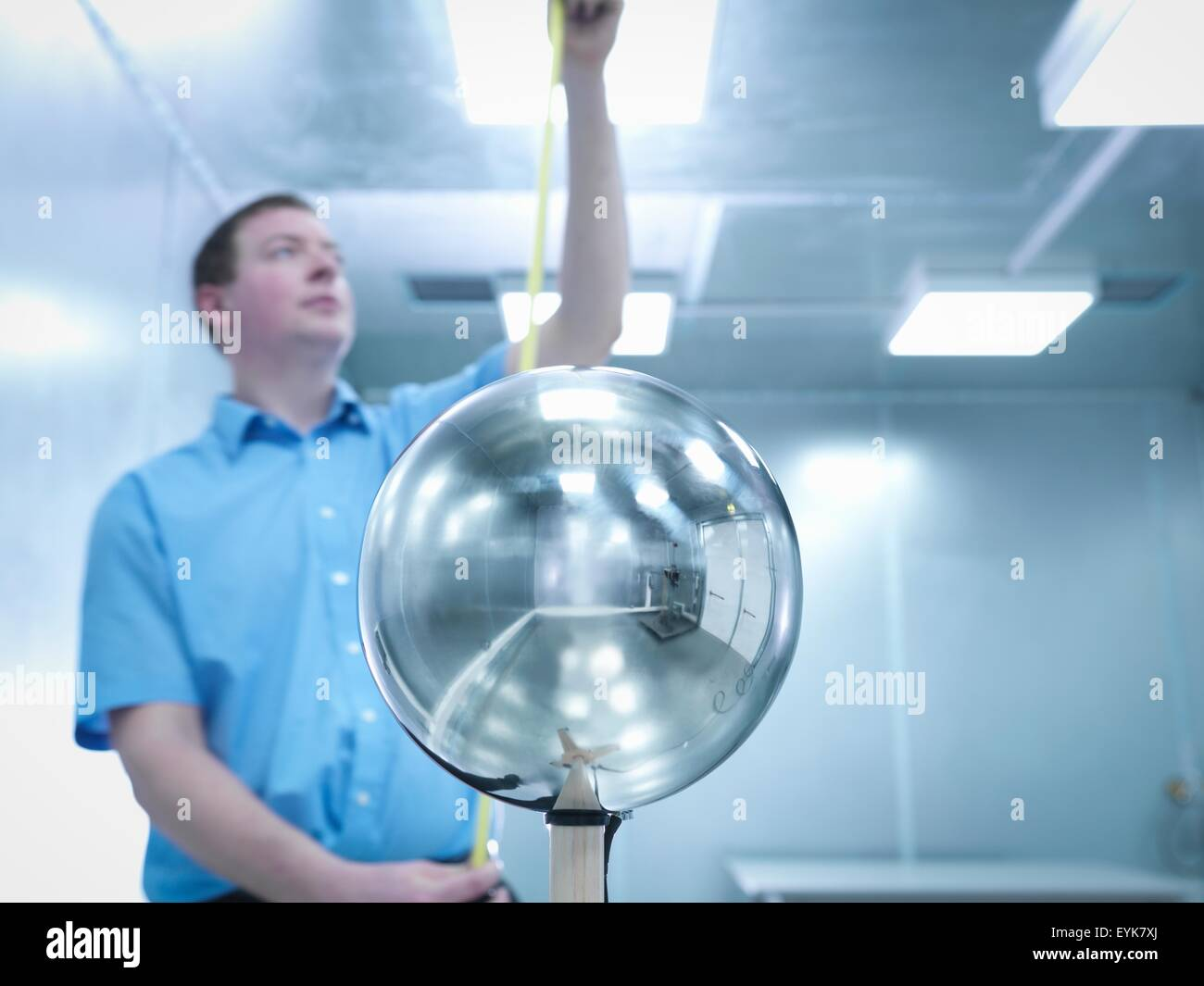 Engineer checking height of equipment under test (EUT) with Van Der Hoofden Head used during electromagnetic field - Stock Image