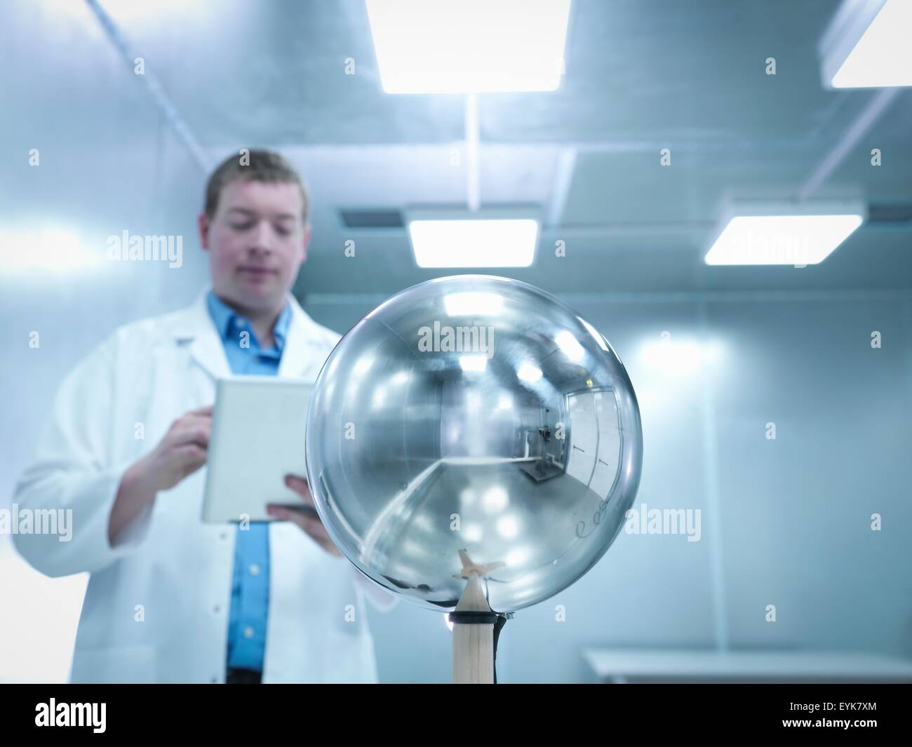 Engineer carrying out electromagnetic field (EMF) testing of electronic lighting using Van Der Hoofden Head - Stock Image