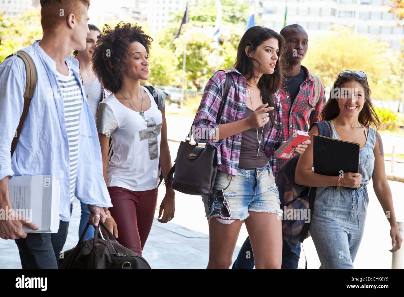 Higher education students walking - Stock Image