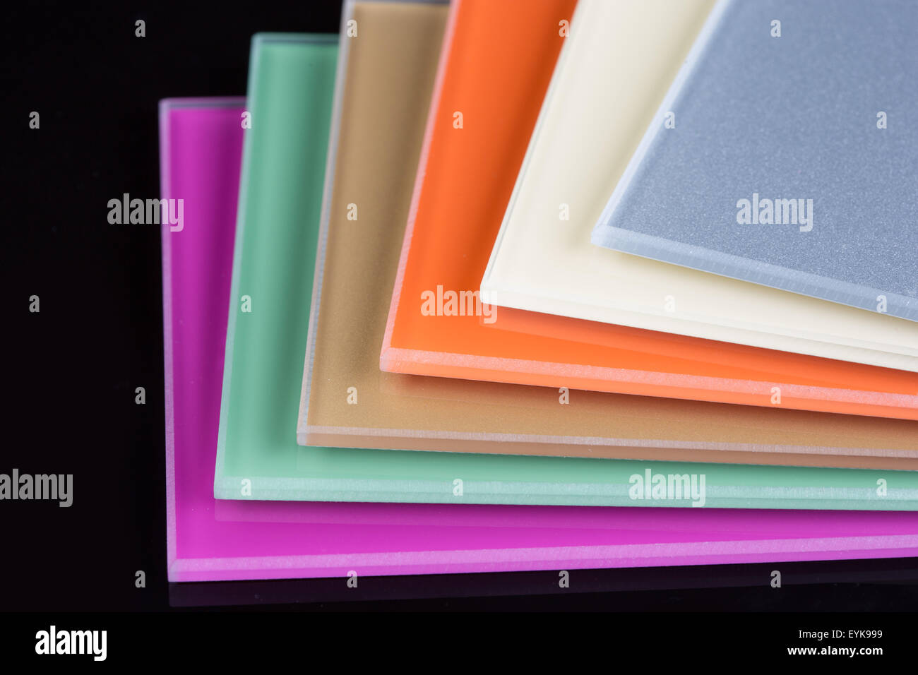 a stack of colored glass on a black background. glass sheets Stock ...