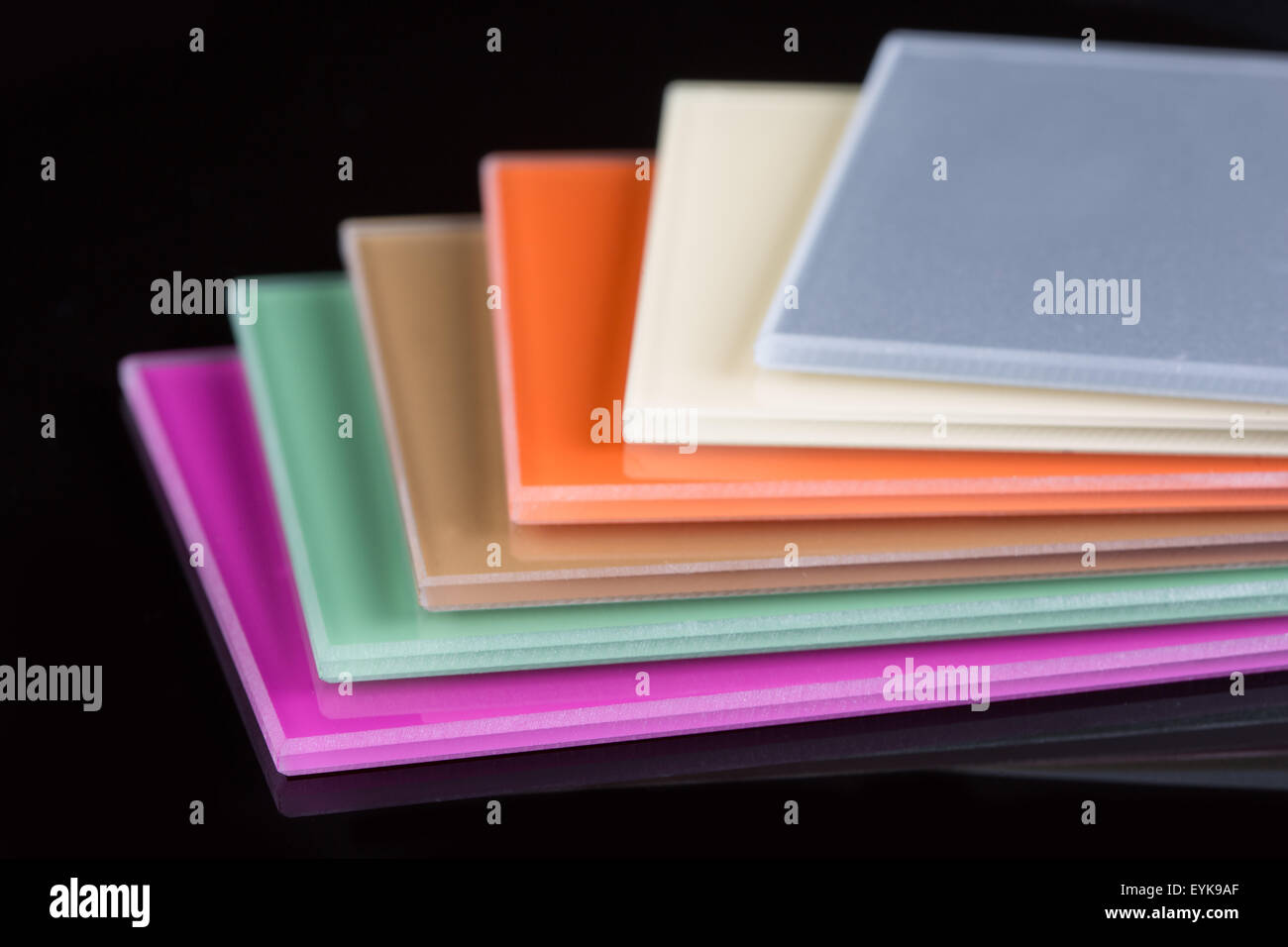a stack of colored glass on a black background glass sheets - Colored Glass Sheets