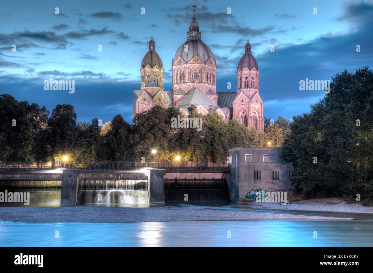 St Luke's Church in Munch at night, alongside the River Isar. Stock Photo