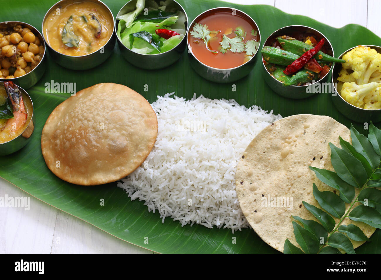 meals served on banana leaf, traditional south indian cuisine - Stock Image