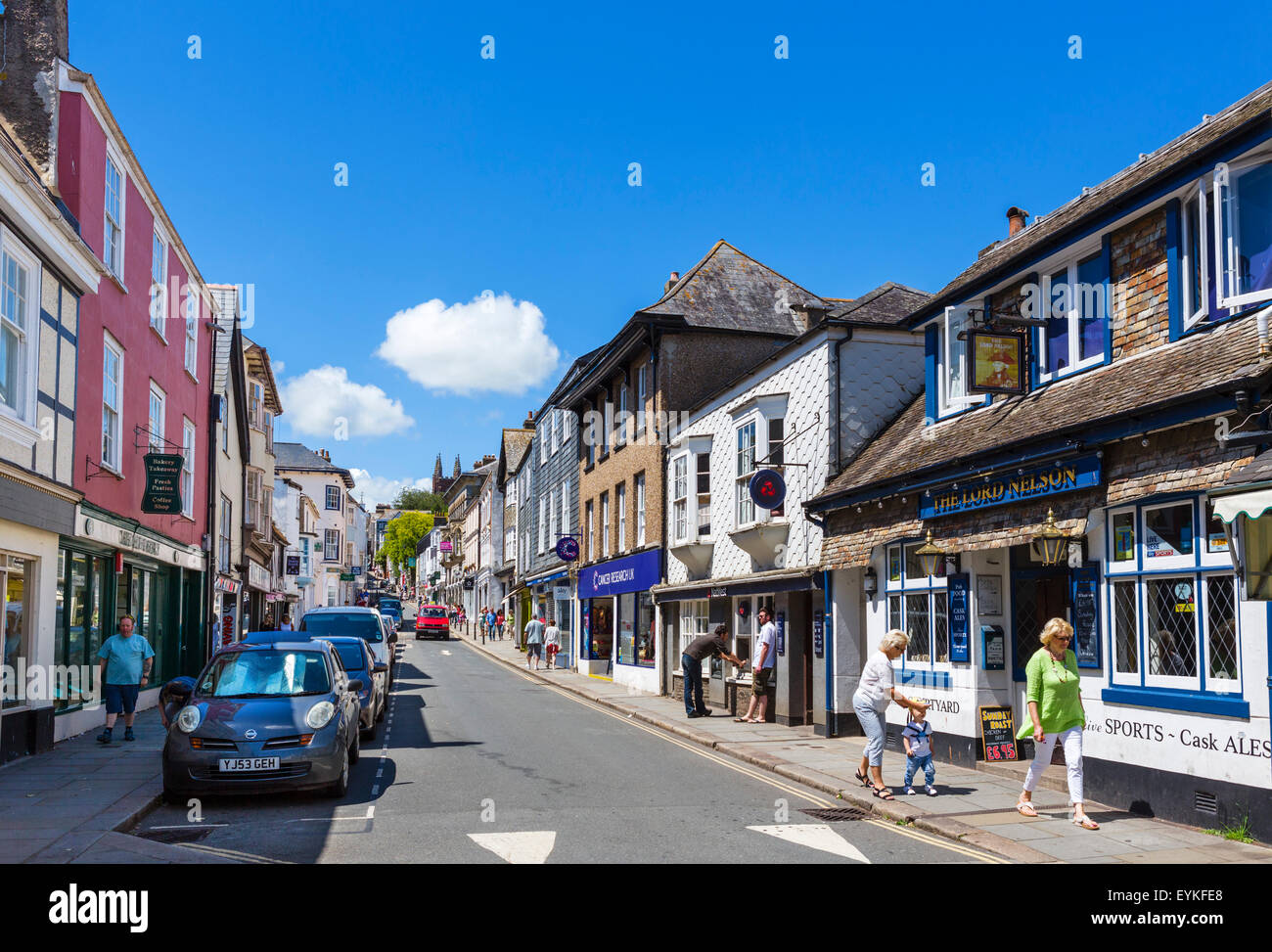 Shops and pub on Fore Street in the town centre, Totnes, Devon, England, UK - Stock Image