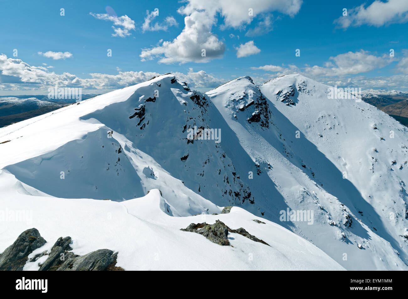 Snow cornices and drifts on the summit ridge of Ben Lomond, Stirlingshire, Scotland, UK, after heavy a spring snowfall. Stock Photo