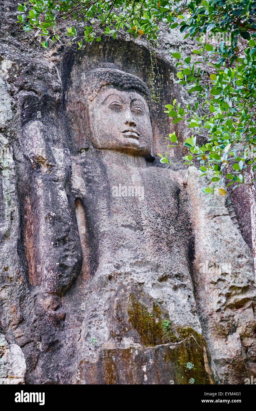 Sri Lanka, Ceylon, Central Province, Ella, Dowa Rock Temple, Buddha statue carved in a rock Stock Photo