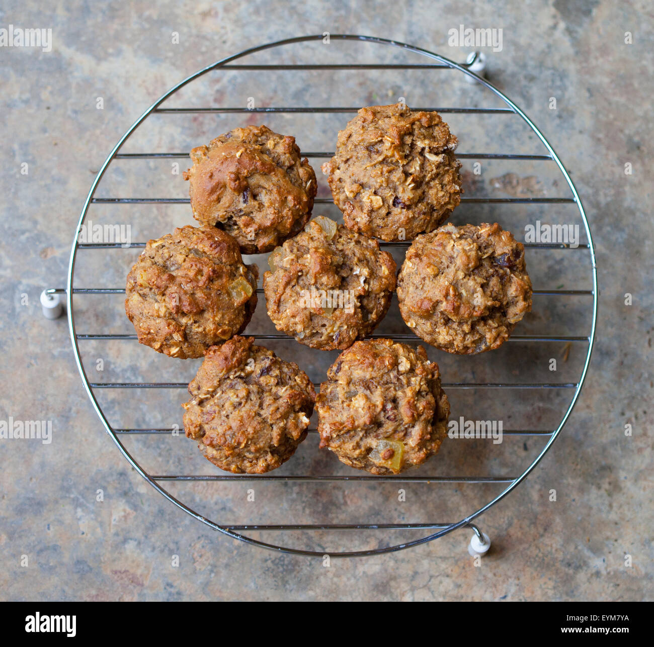 Freshly baked bran muffins cooling on a rack - Stock Image