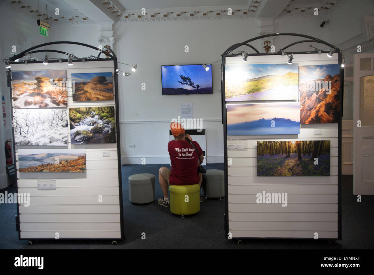 Person watching a multimedia image display in the Dartmoor national park visitor centre, Princetown, Devon, England, - Stock Image
