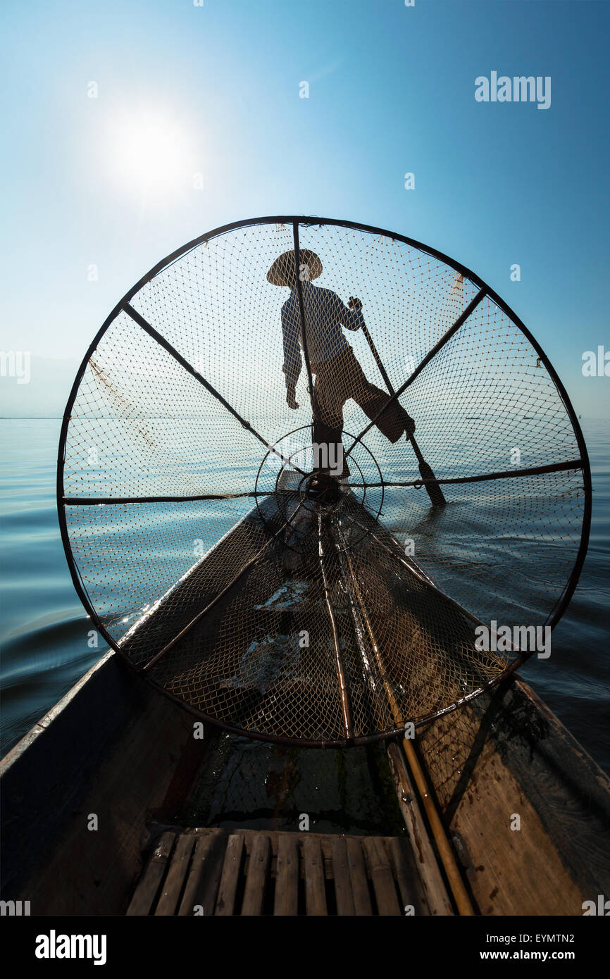 Myanmar travel attraction landmark - Traditional Burmese fisherman with fishing net at Inle lake in Myanmar famous - Stock Image