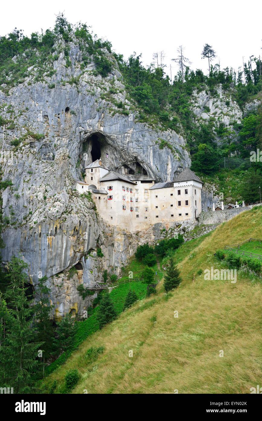 CASTLE IN CLIFF. Predjama Castle, Predjamski, Inner Carniola, Slovenia. - Stock Image