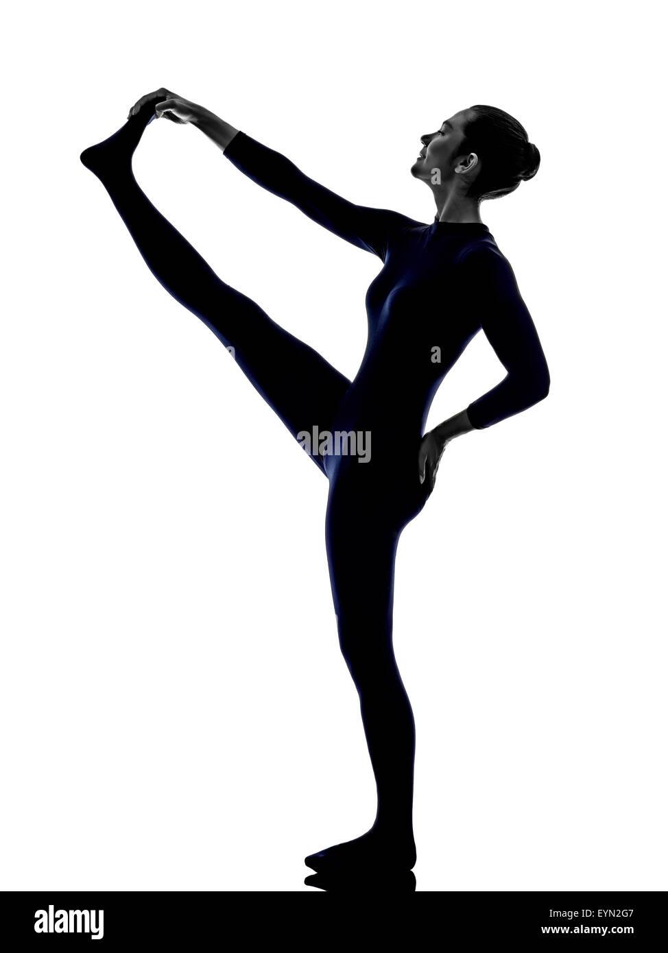 woman exercising Hasta Padangusthasana hand to big toe pose yoga silhouette shadow white background - Stock Image