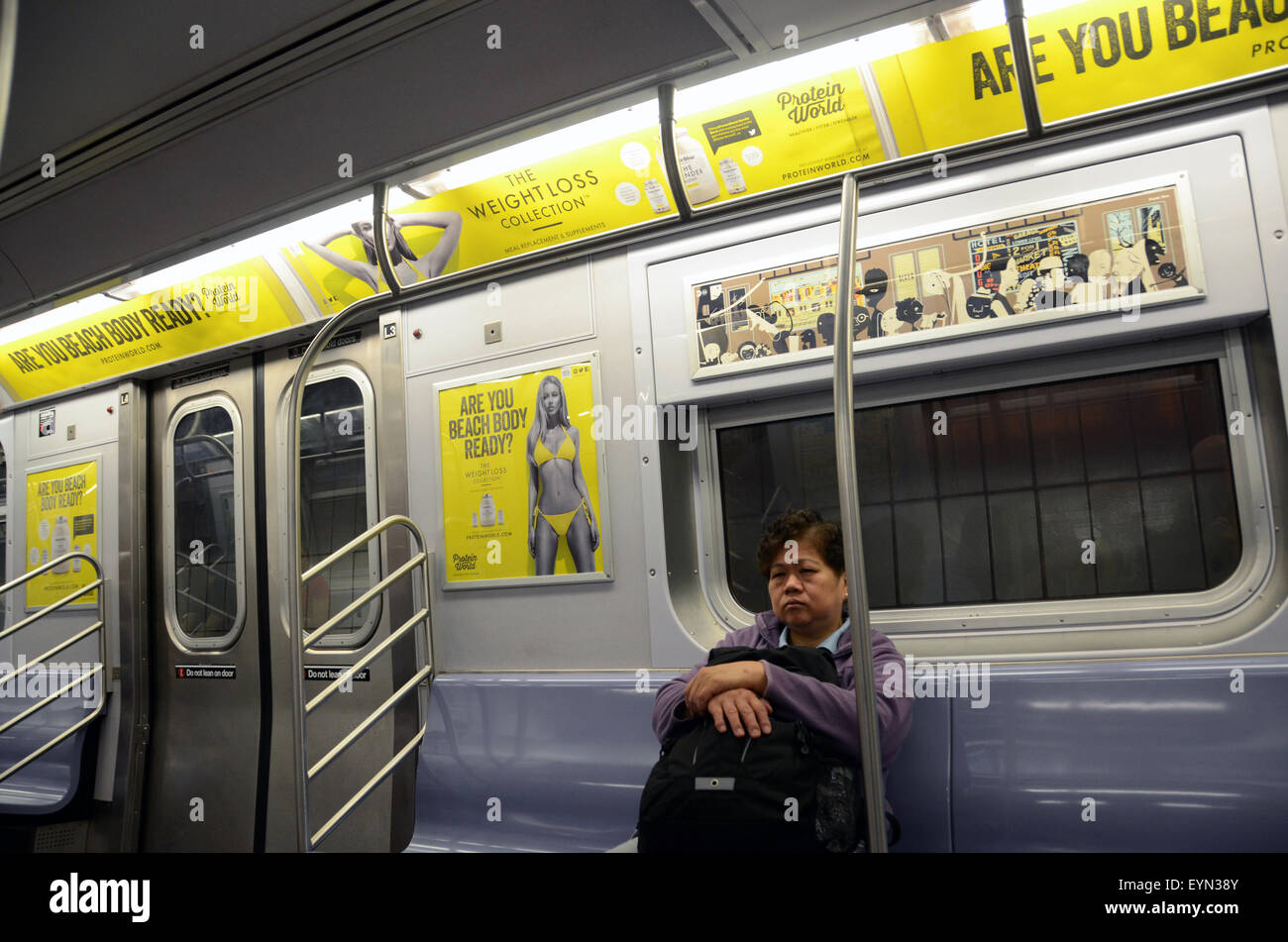 protein world advert beach body ready weightloss collection subway tube underground advert controversial poster - Stock Image