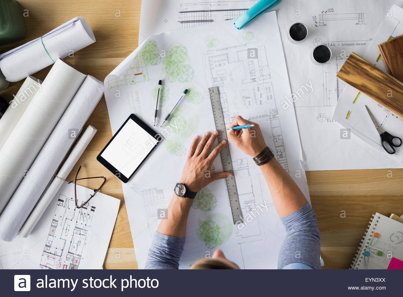 Overhead view architect drafting blueprints at table stock photo overhead view architect drafting blueprints at table malvernweather Choice Image