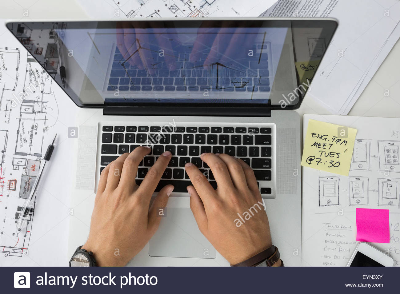 Overhead view architect using laptop - Stock Image