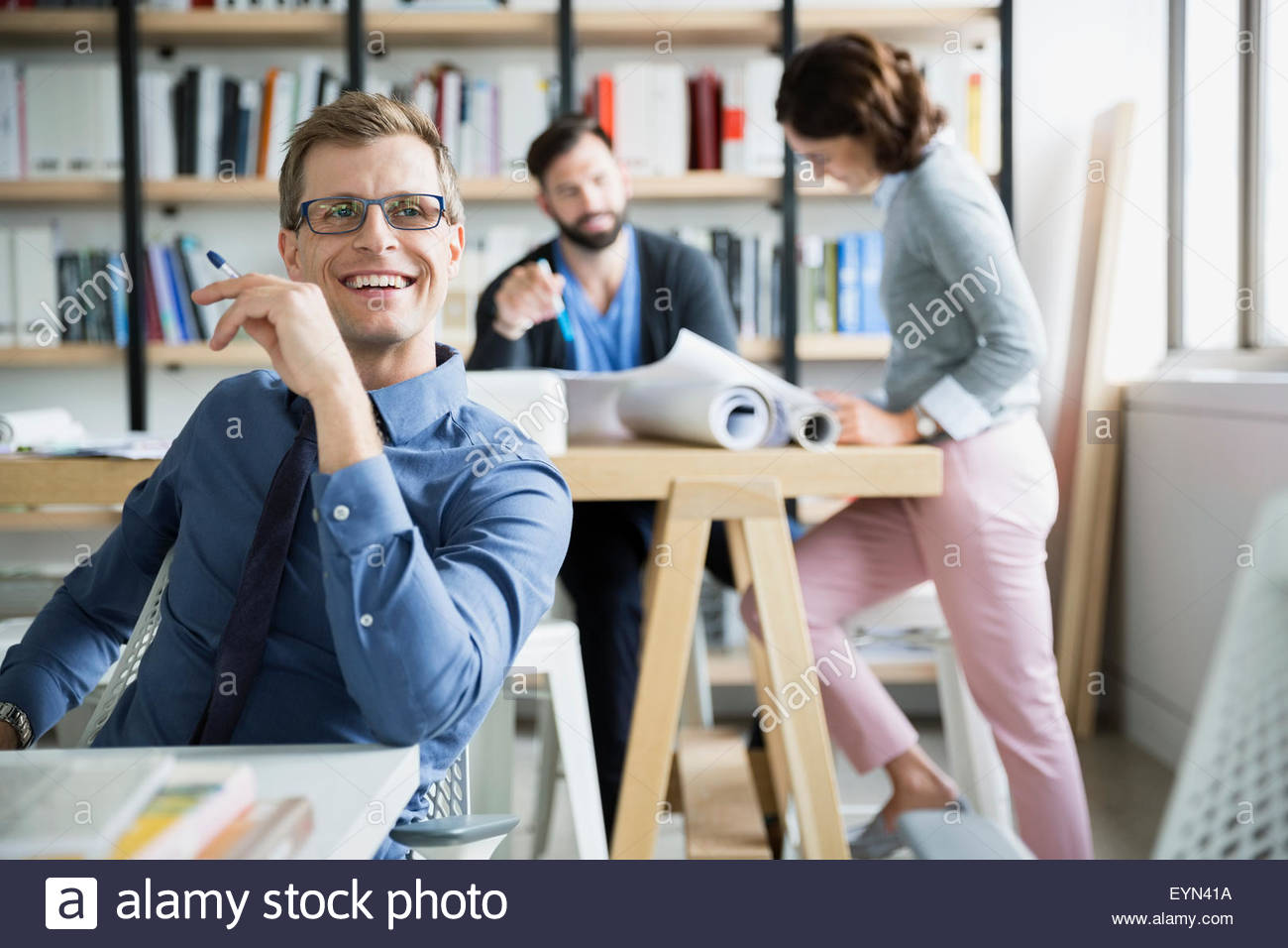 Smiling architect in office - Stock Image