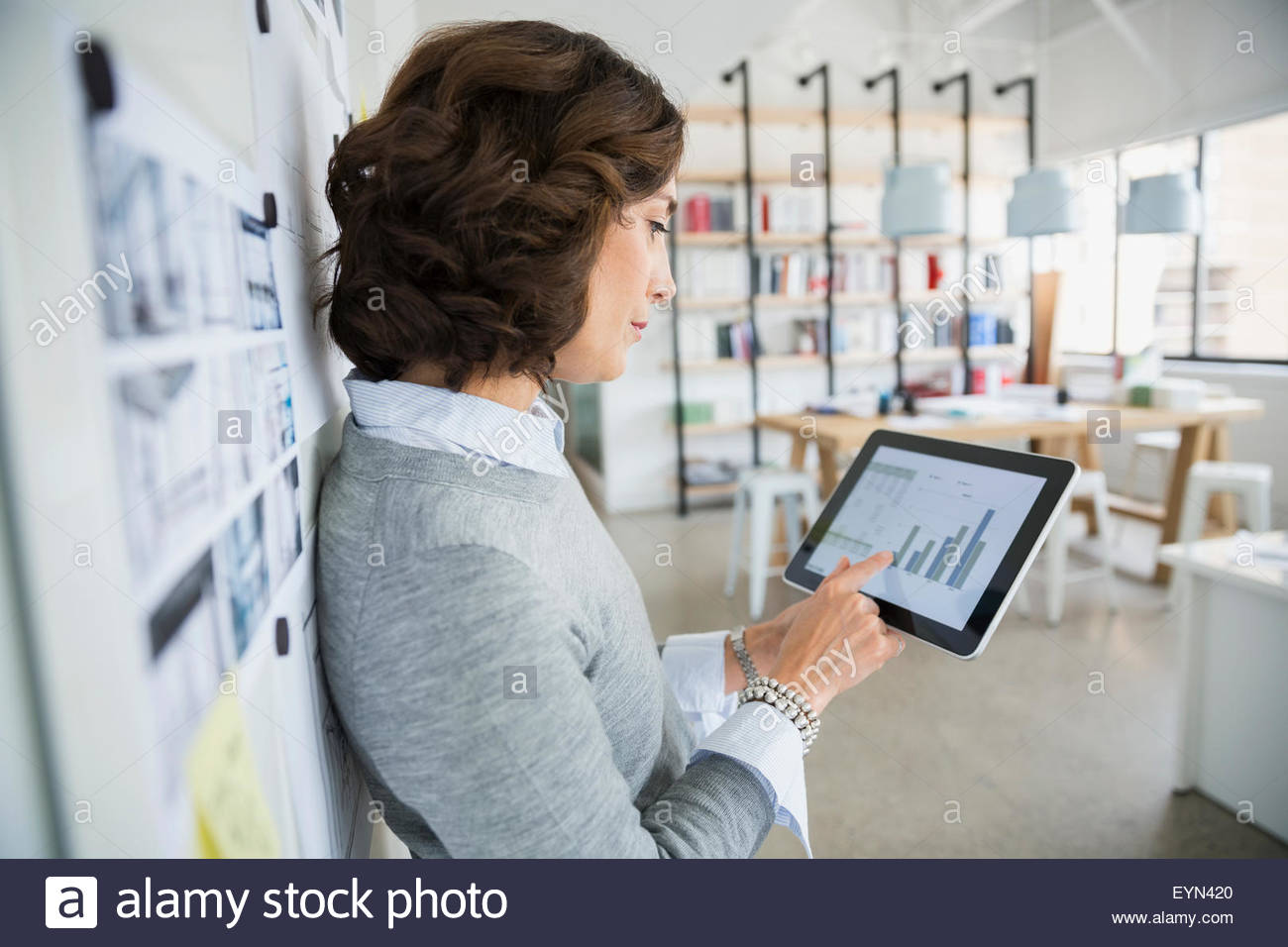 Architect viewing bar graph on digital tablet office - Stock Image