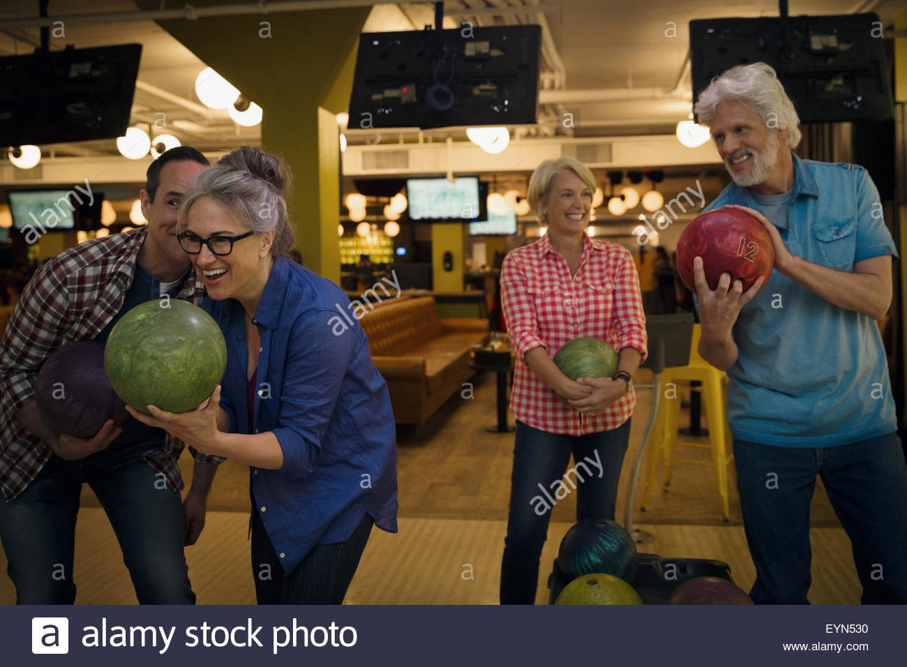 Friends bowling at bowling alley Stock Photo