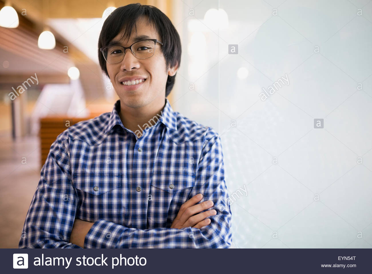 Portrait confident businessman with arms crossed - Stock Image