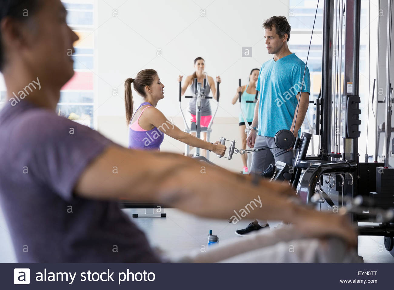 People working out at gym - Stock Image